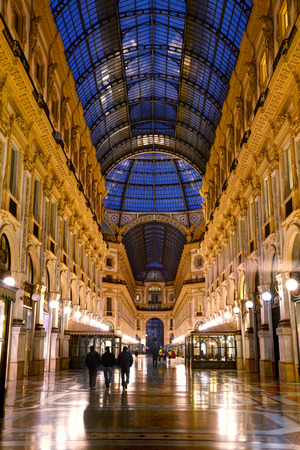 shopping mall interior: MILAN, ITALY - NOVEMBER 25: Galleria Vittorio Emanuele II shopping mall interior with people early in the morning on November 25, 2015 in Milan, Italy.