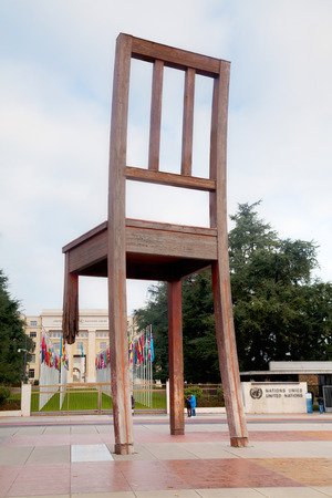 broken chair: GENEVA, SWITZERLAND - NOVEMBER 28: Broken Chair monument near United Nations palace with tourists on November 28, 2015 in Geneva, Switzerland. Editorial
