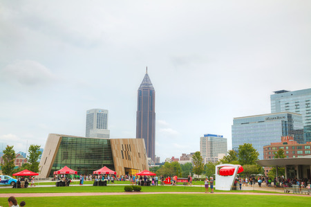 centennial: ATLANTA - AUGUST 29: World of Coca-Cola in Centennial Olympic park with people on August 29, 2015 in Atlanta, GA.