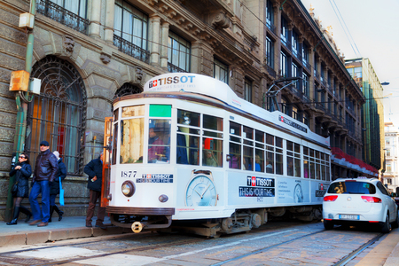 tramway: MILAN, ITALY - NOVEMBER 24: Old tram with people on November 24, 2015 in Milan, Italy.