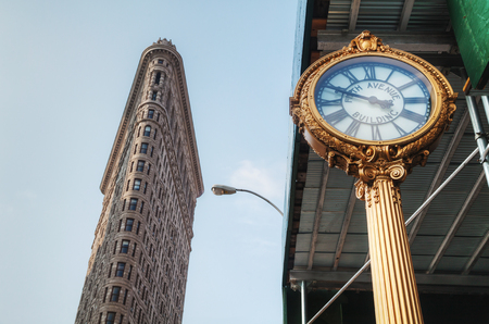 flatiron: NEW YORK CITY - September 4: Flatiron Building on September 4, 2015 in New York. Its located at 175 Fifth Avenue in the borough of Manhattan and is considered to be a groundbreaking skyscraper.