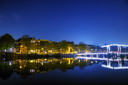 Amsterdam city view with canals and bridges at night Stock Photo