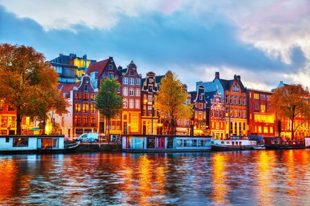 amstel: Amsterdam city view with Amstel river at sunset Stock Photo