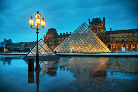 PARIS - NOVEMBER 4: The Louvre Pyramid on November 4, 2016 in Paris, France. It serves as the main entrance to the Louvre Museum. Completed in 1989 it has become a landmark of Paris. Editorial