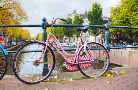 AMSTERDAM - OCTOBER 27: Bycicle parked at the bridge on October 27, 2016 in Amsterdam, Netherlands.