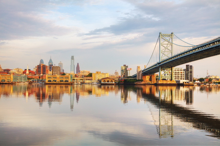 Philadelphia cityscape at sunrise with the Delaware river