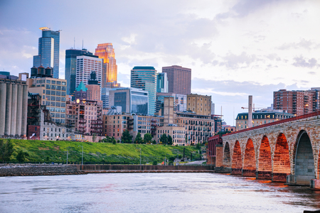 Downtown Minneapolis, Minnesota at night time as seen from the famous stone arch bridge Reklamní fotografie
