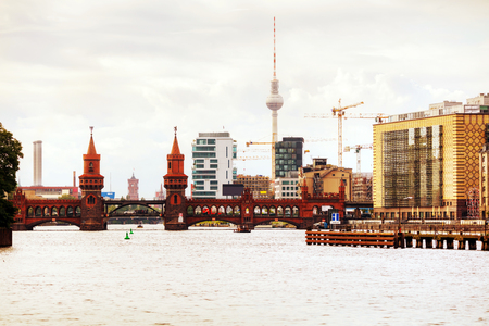 Berlin cityscape with Oberbaum bridge in the evening Editorial