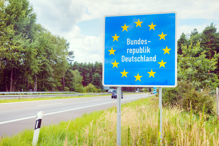 Germany border road sign at the highway Фото со стока