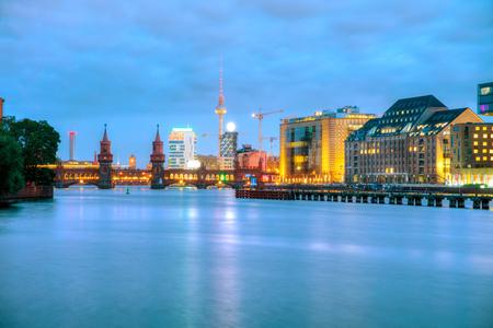 Berlin cityscape with Oberbaum bridge in the evening Stock Photo