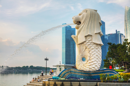 SINGAPORE - OCTOBER 27: Overview of the marina bay with the Merlion and Marina Bay Sands with people on October 27, 2018 in Singapore.