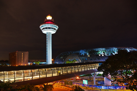 SINGAPORE - NOVEMBER 02: Changi airport control tower at night on November 02, 2018 in Singapore.