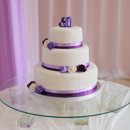 White wedding cake with purple flower detail stock photo picture stock photo white wedding cake with purple flower detail mightylinksfo