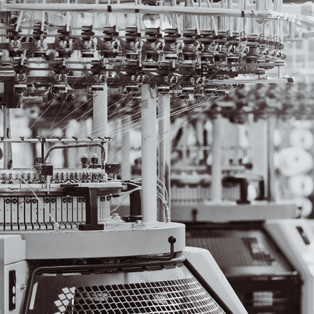 Textile factory. Factory on manufacture of threads. Rows of automated machines for yarn manufacturing. Modern Textile Plant. Banco de Imagens