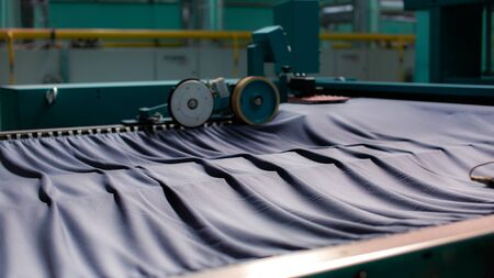 Textile Manufacturing. Knitted fabric. Textile factory in spinning production line and a rotating machinery and equipment production company. Stock fotó
