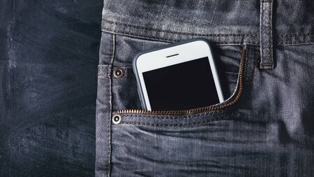 smartphone in the jeans pocket.