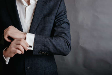 Man in suit hold his white shirt with cuff links. Archivio Fotografico