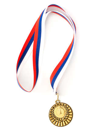 gold medal: Golden medal isolated on white