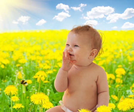 fake smile: Babygirl sitting among dandelion collage Stock Photo