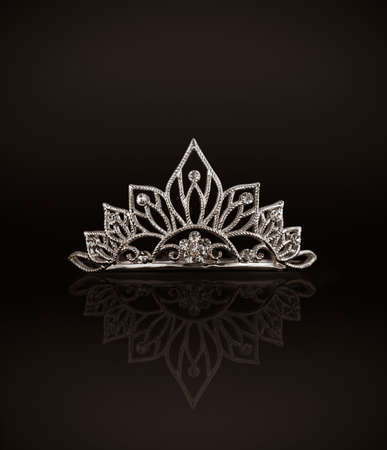 prom queen: Tiara or diadem with reflection on dark background