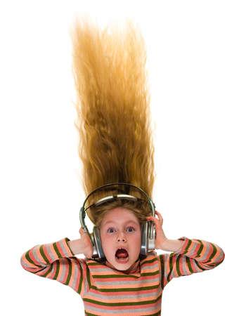 loud: Girl with headphones isolated on white Stock Photo