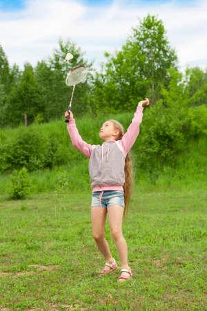 Little girl playing badminton photo