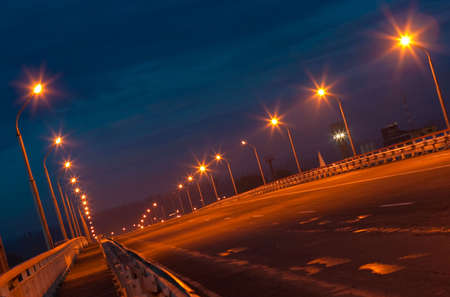 Night shot of empty bridge photo