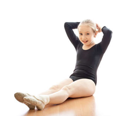 Girl making exercises on floor in bodysuit Stock Photo - 6021314