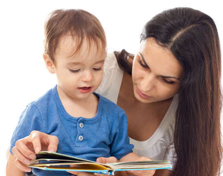 Mother and son reading book together isolated on white Stock Photo - 6021373