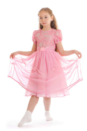 curtsy: Beautiful girl standing on floor in ball dress making curtsy