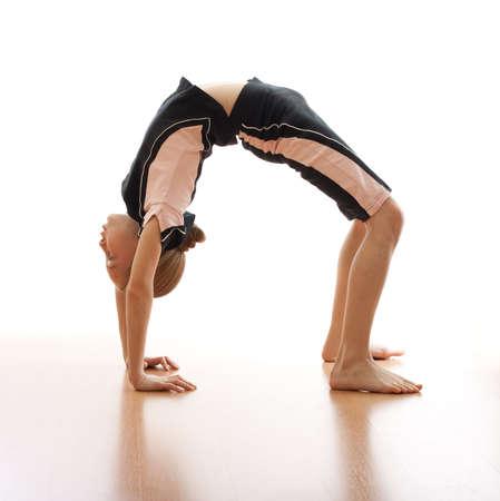 gymnastics girl: Girl making bridge on floor in bodysuit