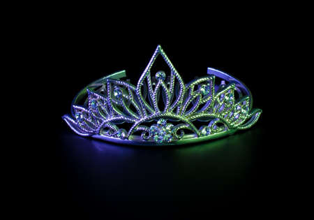 prom queen: Tiara or diadem in neon light on dark background Stock Photo