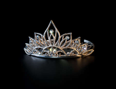 prom queen: Tiara or diadem with colorful sparkles on black background