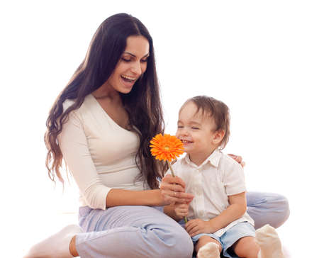 Happy mother and son with flower together isolated on white photo