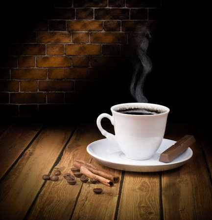 Black hot coffee cup with chocolate and cinnamon photo