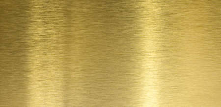 High quality brushed brass texture with light reflection photo