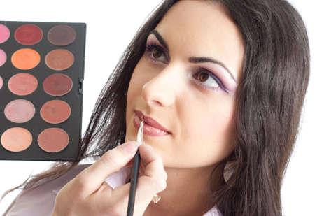 Makeup lips applying photo
