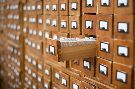 card file: Old wooden card catalogue with one opened drawer
