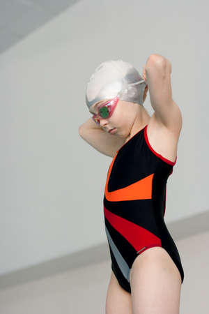 Swimmer girl preparation before start photo