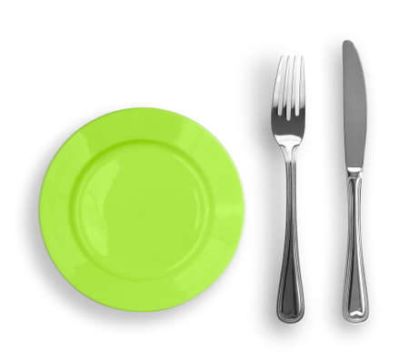 Knife, green plate and fork isolated Stock Photo - 6790795