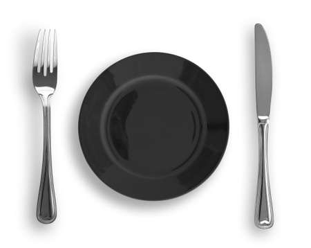 plate setting: Knife, black plate and fork isolated Stock Photo
