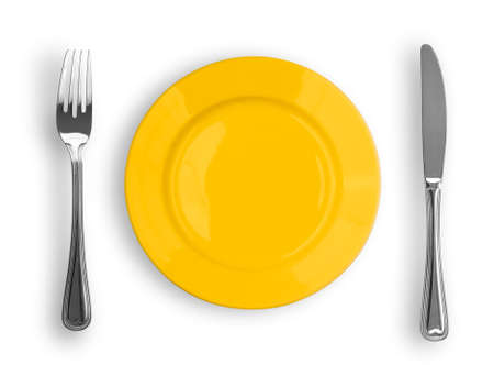 Knife, yellow plate and fork isolated photo