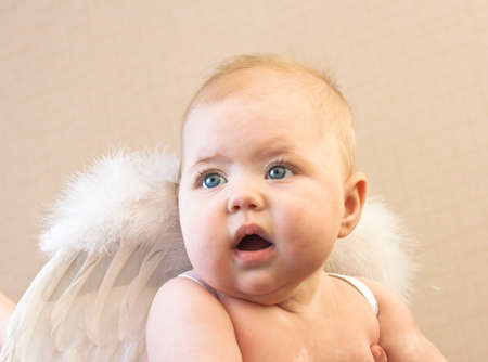 Adorable happy baby with angel wings photo