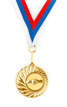 Golden medal with handshake symbol isolated photo