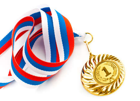 Golden medal isolated on white photo
