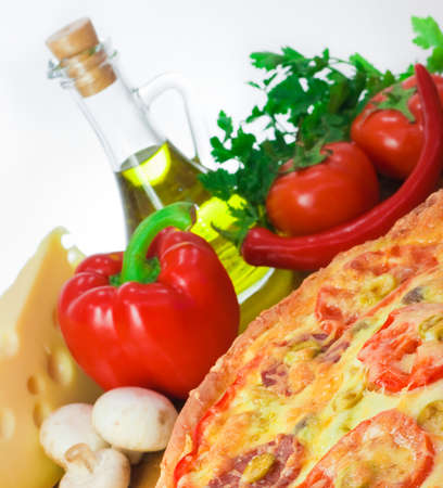 Pizza and ingredients with focus on pizza Stock Photo - 7147893