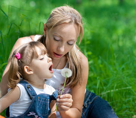 Mother and daughter in jeans with dandelion outdoor Stock Photo - 7307481
