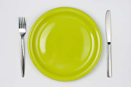 Knife, green plate and fork Stock Photo - 7422340