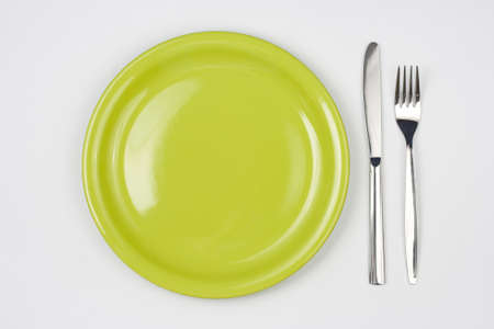 Knife, green plate and fork Stock Photo - 7422339