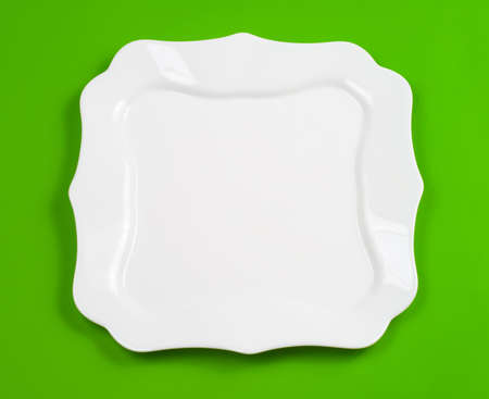 figured: White figured plate on green background